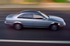 Sedan motorcar on freeway Royalty Free Stock Images
