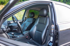 Sedan sport equipment car inside view, leather interior, chromed elements, front and back seats, luxury design Stock Image