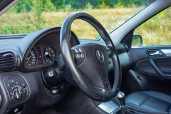 Sedan sport equipment car inside view, leather interior, chromed elements, front and back seats, luxury design Royalty Free Stock Images