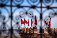Sedda Maroccan flaggor arkivfoton