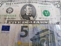 sedel av fem euro och dollarräkning för amerikan fem, bakgrund och textur Arkivfoton