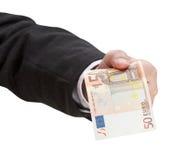 Sedel för euro femtio i det manliga handslutet upp Royaltyfria Bilder