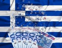 sedel för euro som 20 upplöser som ett begrepp av den ekonomiska krisen i G Royaltyfria Foton