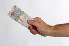 Sedel för kuwaitisk dinar i hand Fotografering för Bildbyråer
