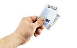 Sedel i valör av euro 20 i hand Arkivfoton
