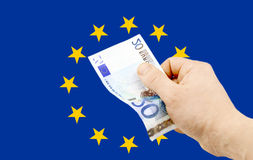 Sedel i valör av euro 20 i hand Royaltyfria Bilder