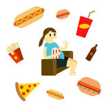 Sedentary woman eating fast food on the couch. Stock Photos
