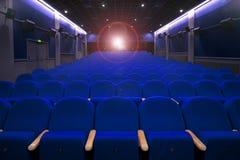 Sedi con l'indicatore luminoso del projecton Immagini Stock