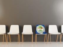 Sedia con la bandiera di Belize Immagine Stock