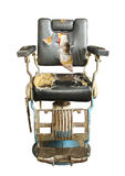 Vecchia sedia di barbiere Immagine Stock