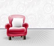 Sedia di cuoio rossa con un cuscino bianco nell'interno leggero Immagini Stock Libere da Diritti