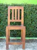 Sedia di legno nel giardino Fotografia Stock Libera da Diritti