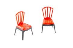 Sedia di plastica rossa su fondo bianco Fotografia Stock Libera da Diritti