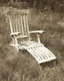 Sedia di salotto nel campo strutturato nello stile d'annata Fotografia Stock Libera da Diritti