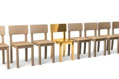 Sedia dorata in una fila Fotografia Stock Libera da Diritti