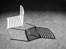 Sedia ed ombra fotografia stock