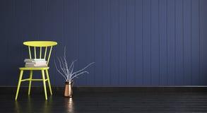 Sedia gialla con i libri sul fondo di legno scuro vuoto della parete Fotografie Stock Libere da Diritti