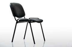 Sedia nera dell'ufficio, studio isolato Fotografia Stock