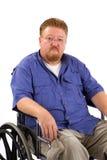 Sedia a rotelle dell'uomo triste Immagine Stock Libera da Diritti