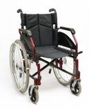 Sedia a rotelle su bianco Fotografia Stock