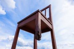 Sedia rotta Ginevra davanti alla costruzione di nazione unita Immagine Stock