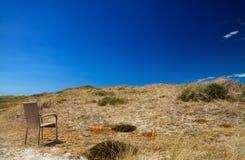 Sedia sulle dune Fotografie Stock Libere da Diritti