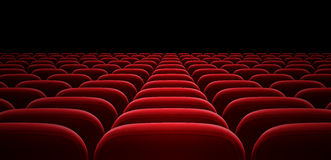 Sedie rosse del bracciolo del corridoio del cinema o della sala Immagine Stock