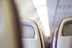 Sedile del passeggero, interno del concetto di viaggio dell'aeroplano immagini stock libere da diritti