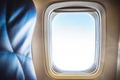 Sedile e finestra dell'aeroplano Fotografie Stock Libere da Diritti