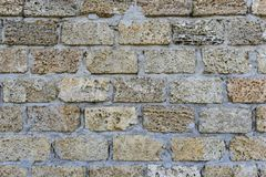 Sedimentär stenvägg, staket, yttersida, textur Brett använt i kust- ställen för byggandevägg av huset eller staketet, Ukraina Arkivbild