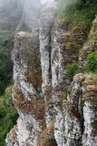 Sedimentary clifftop, in the fog Royalty Free Stock Photos