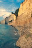 Sedimentary Rock Cliff at the sea, Limestone Natural Structure Coast, Mointain Chain of Layered Stone Formation along the Beach, H. Sedimentary Rock Cliff at the stock image