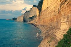 Sedimentary Rock Cliff at the sea, Limestone Natural Structure Coast, Mointain Chain of Layered Stone Formation along the Beach, H. Sedimentary Rock Cliff at the royalty free stock photography
