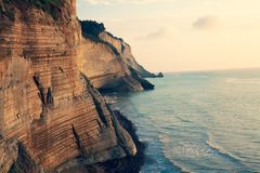 Sedimentary Rock Cliff at the sea, Limestone Natural Structure Coast, Mointain Chain of Layered Stone Formation along the Beach, H. Sedimentary Rock Cliff at the royalty free stock photos