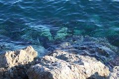 Sedimentary rocks on the shore royalty free stock photography