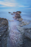 Sedimentation. Long exposure on the coast Stock Photos