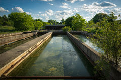Sedimentation Tanks at Abandoned Sewage Treatment Plant Stock Photos