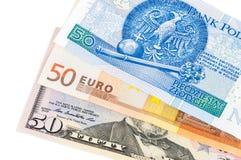 Sedlar av 50 dollar euro och polermedelzloty Royaltyfri Fotografi