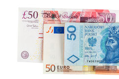 Sedlar av 50 pund euro och polermedelzloty Royaltyfri Foto