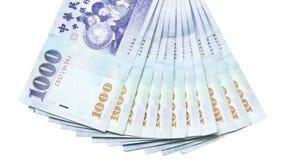 Sedlar för Taiwan dollar på vit bakgrund Arkivbild