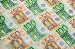 Sedlar 50 och closeup för euro 100 Fotografering för Bildbyråer