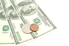 Sedlar och dollar mynt på vit Royaltyfria Foton