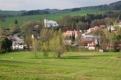 Sedlonov in Orlicke Mountains, Czech republic. Village Sedlonov with Church of All Saints, Orlicke hory, Czech republic Stock Photo