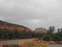Sedona Arizona cloudy day. This is Sedona Arizona on overcast day.  The beautiful red rocks and the clouds in the sky are a wonderful backdrop.  There are Stock Photography