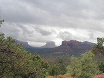 Sedona Arizona cloudy day. This is Sedona Arizona on overcast day.  The beautiful red rocks and the clouds in the sky are a wonderful backdrop.  There are Stock Images