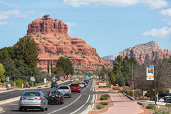 Sedona, Arizona, USA - March 23, 2014: A huge, scenic rock formation in Sedona, Arizona. Traffic can be seen in background. Royalty Free Stock Image