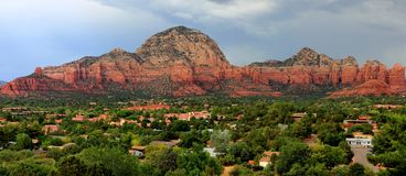 Sedona Az red rock mountains pano. Photo of the iconic red mountains of Sedona AZ during an overcast day. Soft lighting provides strong details and deeper true Royalty Free Stock Images