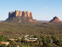 Sedona, chapel view. Sedona: Courthouse Butte and Bell Rock with housing in foreground royalty free stock image