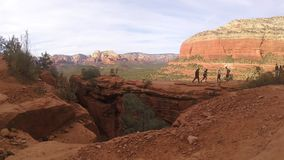Sedona, Devils Bridge hikers pose for photos stock video footage