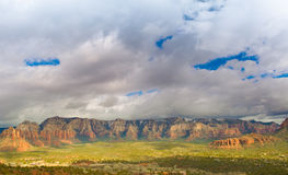 Sedona Mountain Range. Beautiful Sedona Red Rock Mountain Range with a big blue and cloudy sky above royalty free stock photo